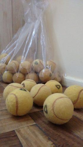 50 pelotas de tenis usadas!!
