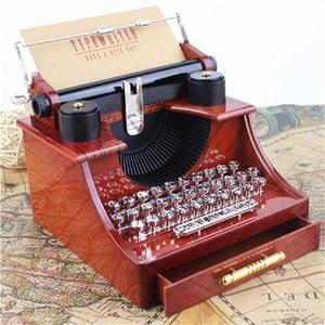 Caja musical máquina de escribir con movimiento