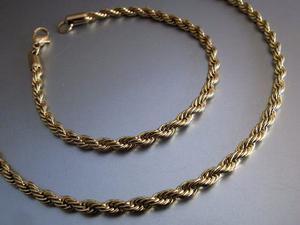 Cadena y pulsera molly en acero dorado, nuevas.