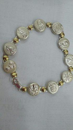d640bd7ac0d7 Argentina. Delicada pulsera de plata y oro.. varios santos y vírgenes