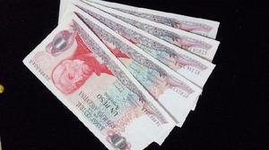 Lote de billetes y monedas argentinas antiguas