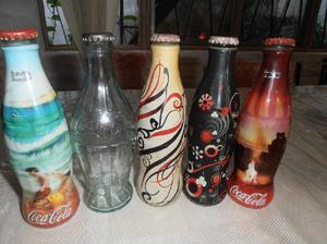 Cinco botellas de 237 cc de coleccion de coca cola