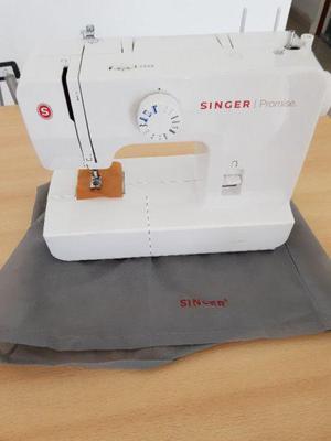 Vendo hermosa maquina de coser singer nueva