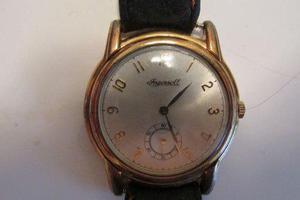 2f0c060a0ea9 Reloj a pila dorado malla cuero marron impecable
