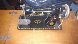 Máquina de coser antigua lander
