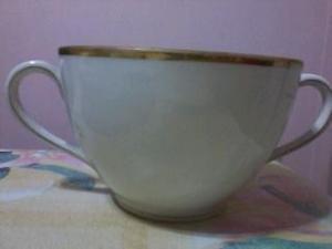 Antigua taza francesa de porcelana sellada paris exp. 1900