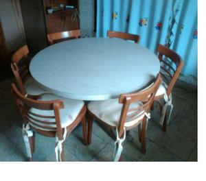 Mesa redonda y 6 sillas