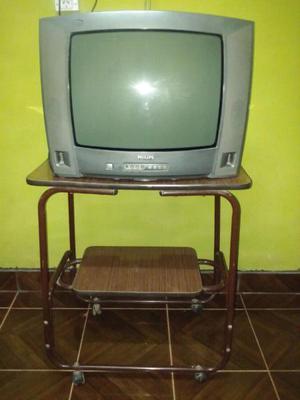 Televisor philips con mesa de tv y audio