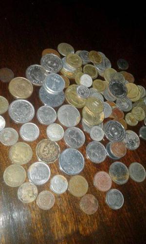 Lote de cien monedas argentinas y otros paices