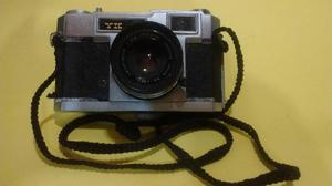 Antigua cámara de foto yashica yashinon.
