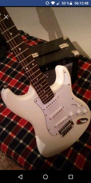 Guitarra eléctrica sx más amplificador