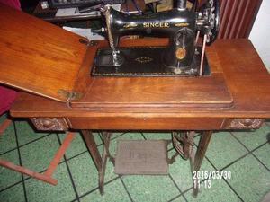 Maquina de coser singer 14500.-
