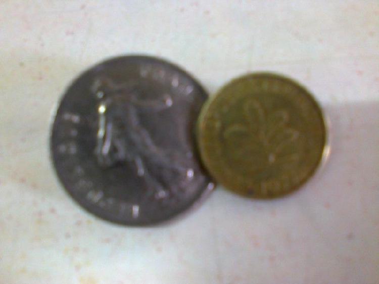 Monedas anilladas para rastra de francia y alemania