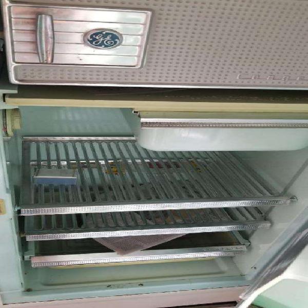Heladera general electric con congelador. impecable