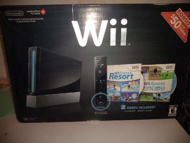 Nintendo wii negra usada y 2 juegos originales. en caja.