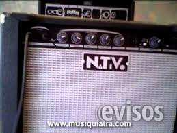 Guitarra electrica y amplificador para guitarra y bajo