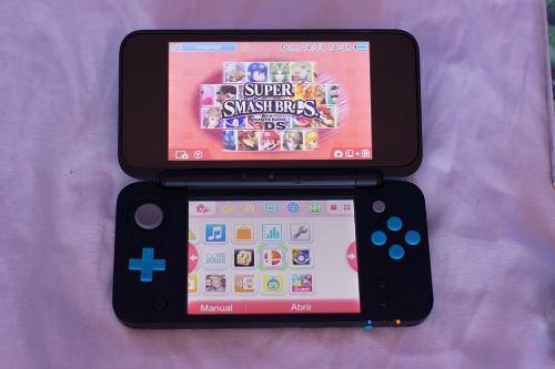 Nintendo 2ds xl turquoise + super smash bross