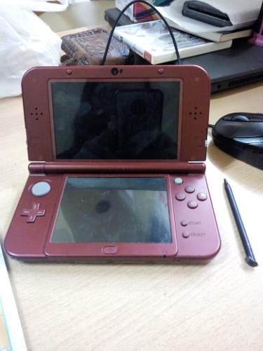Nintendo new 3ds xl + cargador + 2 juegos digitales