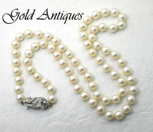 Collar de perlas naturales con broche de oro 18 kt y brillan