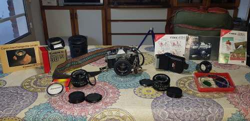 Espectacular canon ae-1 con lentes y accesorios!