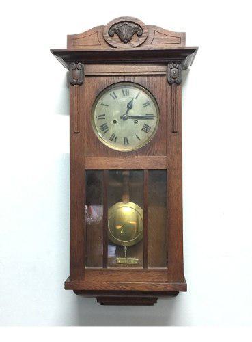 Antiguo reloj caja de roble llave y pendulo funciona 1940