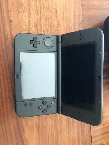 Nintendo 3ds xl black con 4 juegos