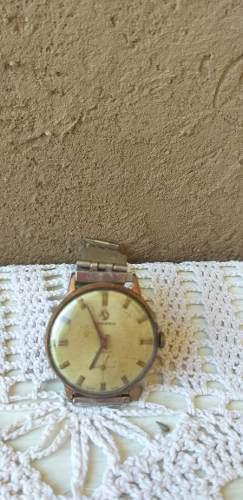 Reloj pulsera tressa antiguo funcionando