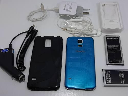 Samsung s5 + funda + 2 bateria extra + cargador externo +