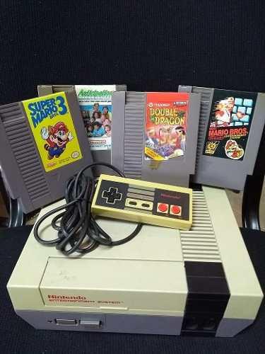 Nintendo nes original vintage con juegos joystick