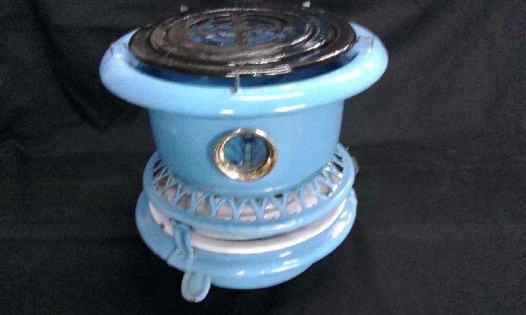 Calentador antiguo a kerosene con 2 mecha