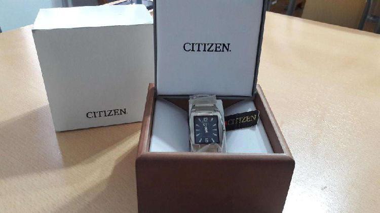 Reloj citizen hombre fondo azul.-