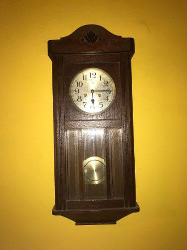 Reloj antiguo de pared - péndulo alemán el águila
