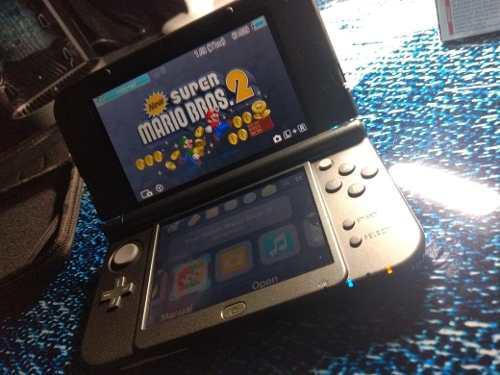 Consola portátil nintendo 3ds xl + 4 juegos + funda