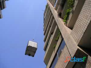 Servicio de subir y bajar muebles con sogas por balcón