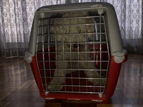 Jaula transportadora para mascotas.