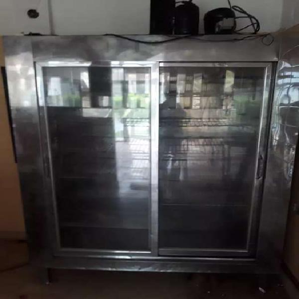 Se vende heladera vertical de 2 puertas excibidora , de va