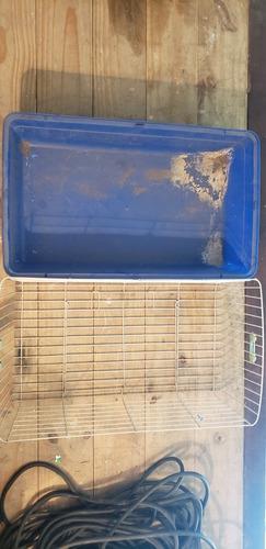 Jaula para conejos usada