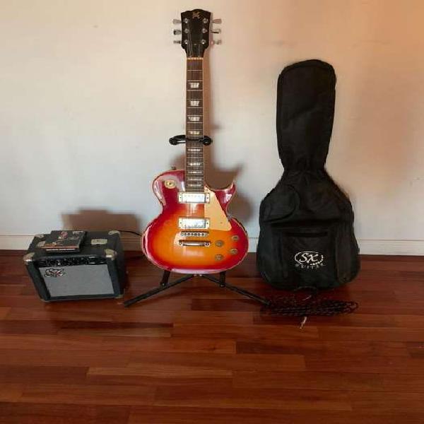 Guitarra eléctrica sx les paul completa con accesorios.