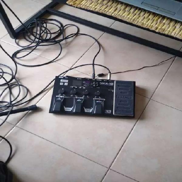 Guitarra+ amplificador + pedalera+ micrófono + pie