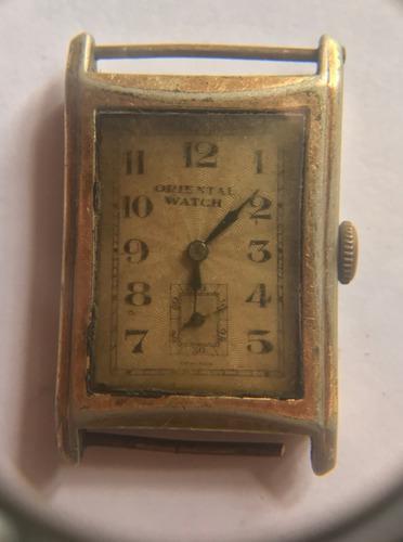 Antigua maquina de reloj suizo marca oriental-a reparar