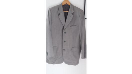 Traje gris saco y pantalon marca buzo traído de holanda