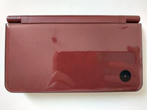 Nintendo dsi xl bordó + cargador + 50 juegos.