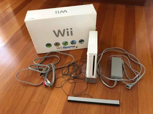 Nintendo wii original con 2 controles + 2 volantes + juegos