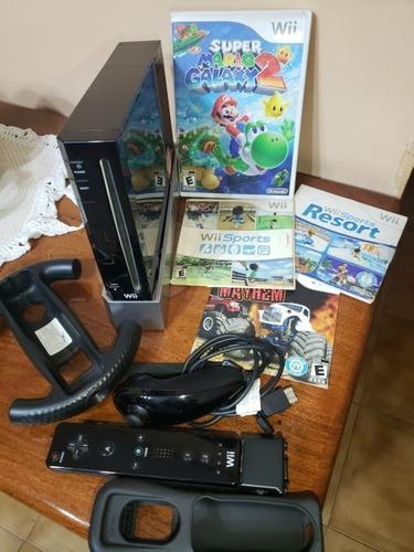 Nintendo wii original en caja + 2 controles y 4 juegos