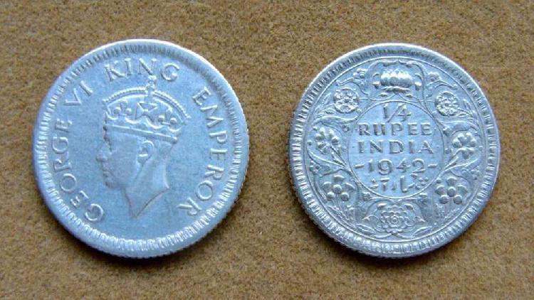 Moneda de ¼ de rupia de plata india británica 1942