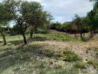 Dos terrenos frente al rio en villa carlos paz, barrio villa