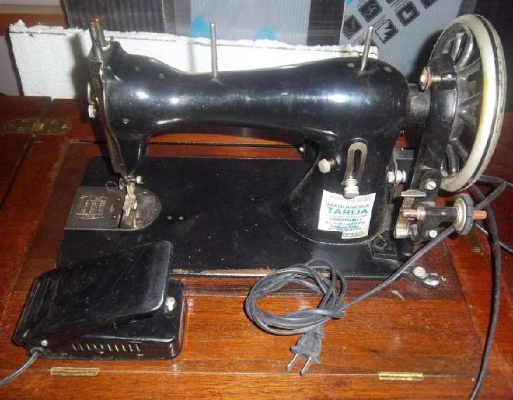 Vendo o canjeo maquina de coser singer con mueble, electrica