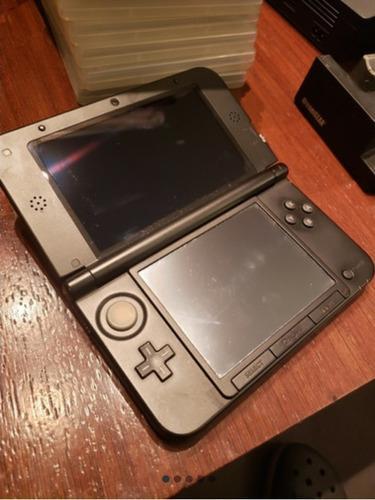 Nintendo 3ds xl con estuche,cargador y dos juegos