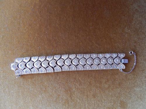 Antigua pulsera dorada con eslabones tipo brazalete