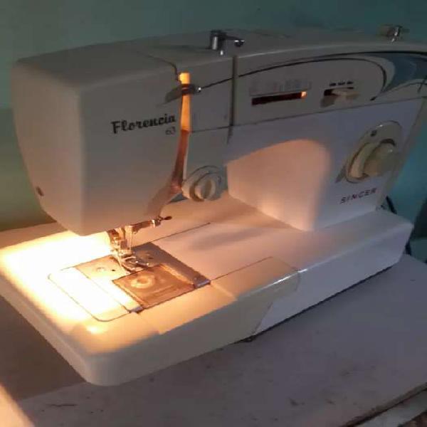 Maquina de coser singer modelo florencia 63.